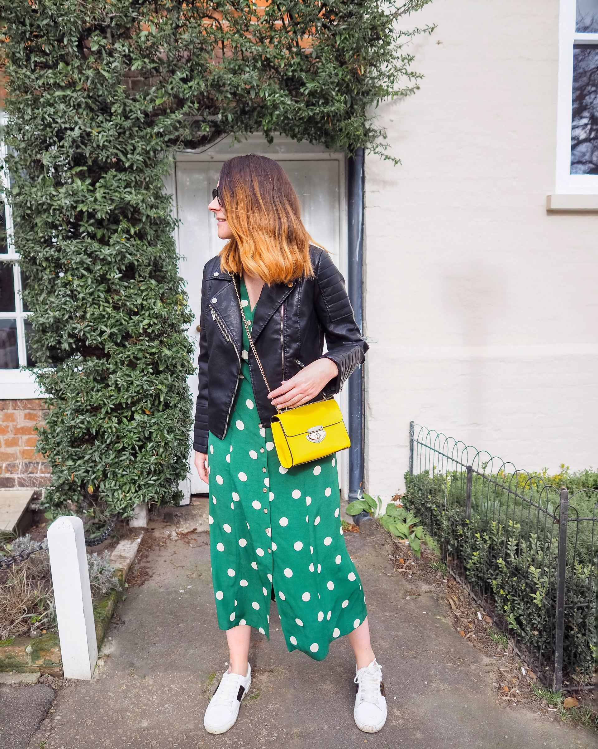 green spotty dress with biker jacket